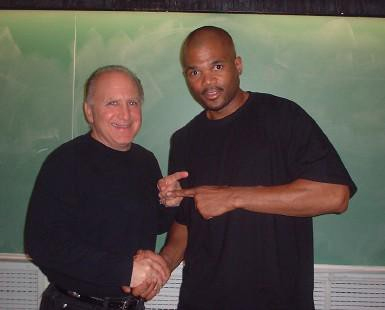 "dr. marcone with run Darryl ""DMC"" McDaniels"