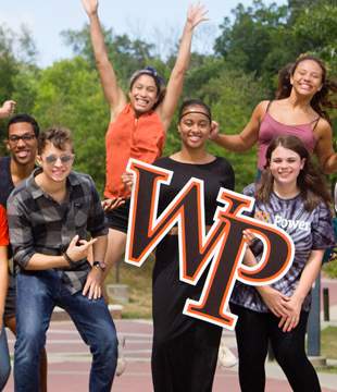 WPU students standing in greens area